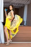 Brunette in yellow dress Stock Photo