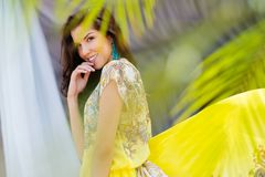 Brunette in yellow dress Royalty Free Stock Photography