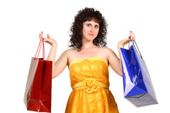 Brunette in a yellow dress with shopping bags Royalty Free Stock Photography