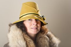 Brunette in yellow felt hat and fur Stock Photos