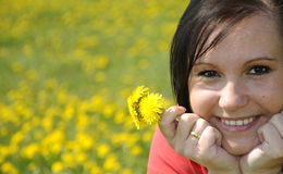 Brunette on yellow meadow Royalty Free Stock Photo