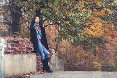 Brunette young fashion woman in autumn park Stock Photos