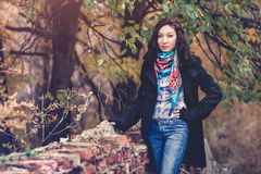 Brunette young fashion woman in autumn park Stock Images