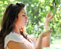 Brunette young girl with an apple Royalty Free Stock Images