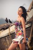 Brunette young girl posing near boat Stock Image