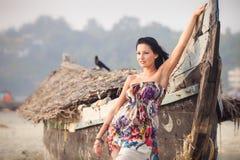 Brunette young girl posing near boat Stock Photo