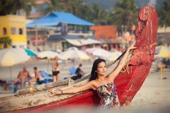 Brunette young girl posing near boat Royalty Free Stock Photo