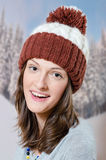 Brunette young girl wearing warm hat in forest Stock Images