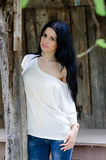 Brunette young girl in white shirt and jean Royalty Free Stock Image