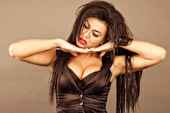 Brunette young woman with creative makeup holding her head on ha Royalty Free Stock Images