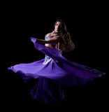 Brunette young woman dancing oriental dance Royalty Free Stock Image
