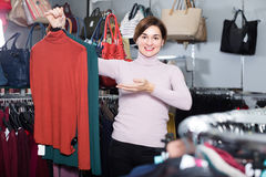 Brunette young woman enjoying her purchases Stock Photography