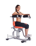 Brunette young woman on exerciser Stock Image