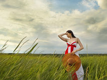 Brunette young woman with hat in summer day Stock Images