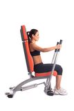 Brunette young woman on hydraulic exerciser Stock Photography
