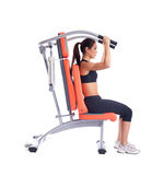 Brunette young woman on isodynamic exerciser Stock Photos
