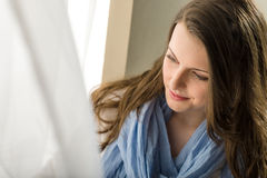 Brunette young woman looking down window Royalty Free Stock Photography