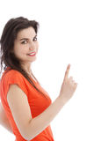 Brunette young woman pointing up Royalty Free Stock Image