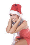 Brunette young woman wearing santa claus h Royalty Free Stock Image