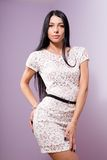 Brunette young woman in white lace dress Stock Image