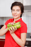 Brunette with zucchini in kitchen Stock Photos
