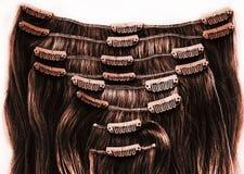 Brunetteclip in der Haarerweiterung Stockfotos