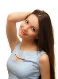 Brunettefrau in einem blauen Kleid Lizenzfreies Stockfoto