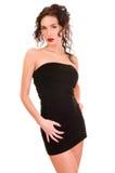 Brunettefrau im Kleid über weißem Hintergrund Lizenzfreie Stockfotografie