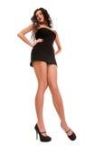Brunettefrau im Kleid über weißem Hintergrund Lizenzfreies Stockfoto