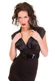 Brunettefrau im Kleid über weißem Hintergrund Lizenzfreie Stockfotos