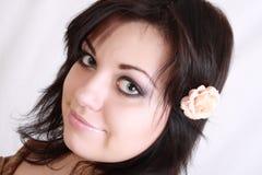 brunetten hör rose Fotografering för Bildbyråer