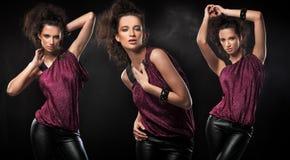 brunetter som poserar sinnliga tre Fotografering för Bildbyråer