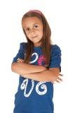 Brunettflicka i blåttöverkant med hennes vikta armar Royaltyfria Bilder