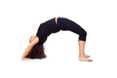 Brunettkvinnan som gör Yoga, övar Arkivbild