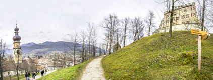 Brunico castle path - Bolzano - Trentino Alto Adige - Italy. Brunico, Italy - December 13, 2014: people follow the path that leads to the castle of the town of stock images