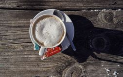 Brunnach Ski Resort, St. Oswald, Carinthia, Austria - January 20, 2019: Cup of coffee captured on an old wooden table stock photo