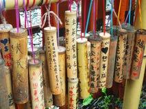 Brunnen önskar skriftligt på bambu Royaltyfri Fotografi