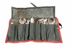 Brunnen benutzte antike Motorradwerkzeugrolle mit Werkzeugen Stockbilder