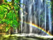 Brunnen mit Regenbogen Stockfotos