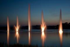Brunnen und Sonnenuntergang Stockfotos