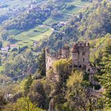 View on Castle Brunnenburg inside Valley and Landscape of Meran. Tirol Village, Province Bolzano, South Tyrol, Italy royalty free stock photos