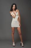 Brunnet woman in white short dress Stock Photo