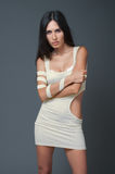 Brunnet woman in white short dress Royalty Free Stock Photo