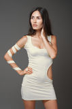 Brunnet woman in white short dress Royalty Free Stock Photos