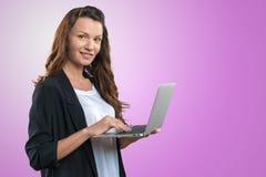 Brunnete woman holding laptop Stock Photo