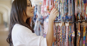 Brunnette Woman Shopping For Clothing Royalty Free Stock Photography