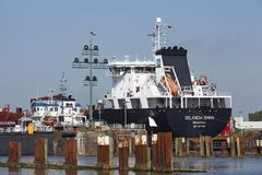 Brunsbuettel - Container vessel at lockage royalty free stock photography