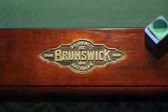 Brunswick Billiards Table with Pool Chaulk Stock Photo