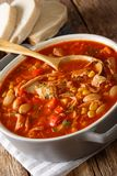 Brunswick Stew - thick, flavorful and hearty one-pot stew with v. Egetables and meat on a chicken broth and BBQ sauce close-up in a bowl on the table. vertical royalty free stock photo