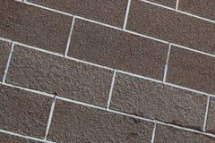 Brunt abstrakt begrepp för closeup för tegelstenvägg Fotografering för Bildbyråer